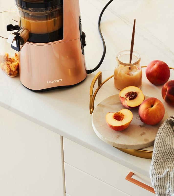 Valentine's Day Gifts, Hurom H-AA Rose Gold Slow Juicer with Peach Juice
