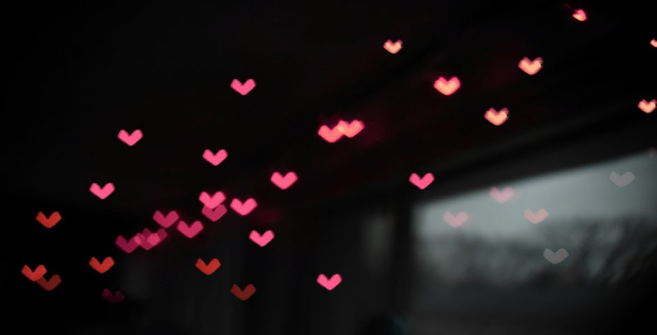 Red lights in the shape of hearts in a bokeh effect